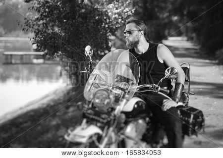 Handsome Biker In Sunglasses With Long Hair And Beard