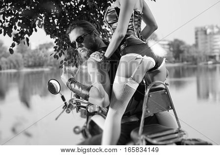 Portrait Of Brutal Biker And Beautiful Sexy Woman On Motorcycle