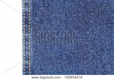 Texture of blue jeans fabric with vertical yellow double stitching isolated on white closeup