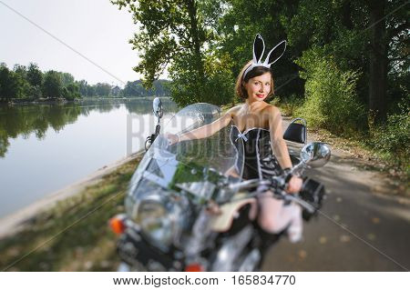 Young Beautiful Sexy Bunny Female On Cruiser Motorcycle