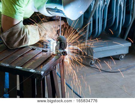 Industrial steel welder in factory working stock image