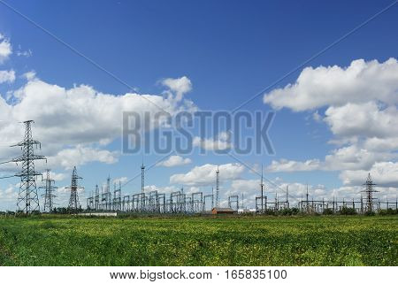 Transmission line and electrical substation on the background of blue sky