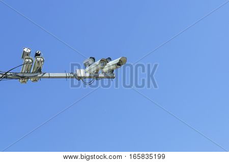 Stationary camera images of traffic violations on blue sky background