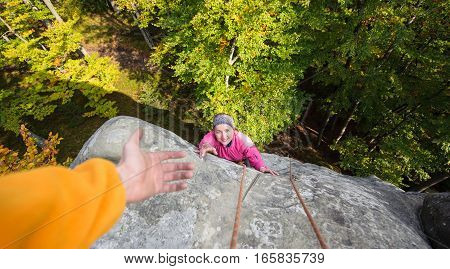 Woman Climbing In The Nature On Large Boulder