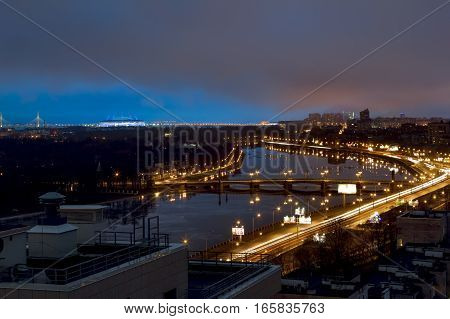 Saint-Petersburg .Russia.December 31 2016.The view from the heights on the river Neva and Ushakovskaya the Embankment in the evening lights in St. Petersburg.