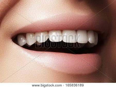 Beautiful smile with whitening teeth. Dental photo. Macro closeup of perfect female mouth lipscare rutine.