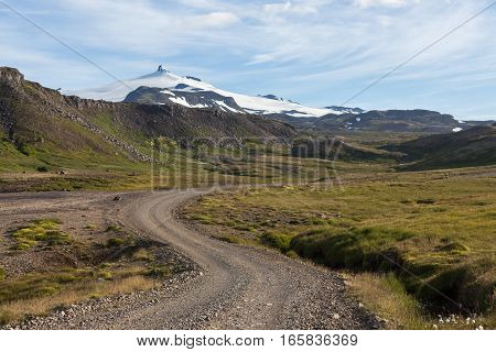 Iceland Rural Road In Beautiful Icelandic Mountain Landscape With White Glacier Cap Of Snaefellsjoku