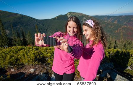 Two Happy Female Hikers Smiling And Taking Selfie Photo