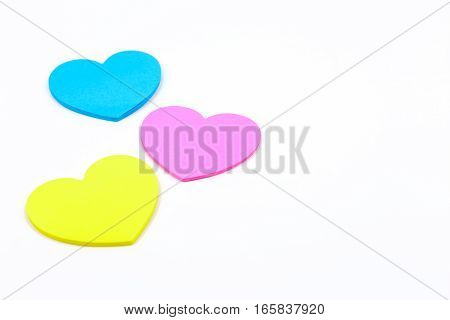 paper hearts shaped colour pink blue and yellow isolated on white background