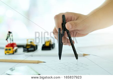 Architect Or Engineer Working On Blueprint.