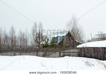 Village In A Winter And Snowfall