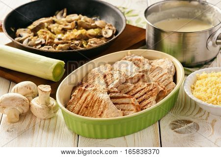 Grilled pork tenderloin with bechamel sauce, mushrooms and mashed potatoes. Cooking process.