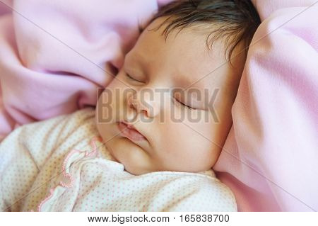 Close-up Of A Baby Girl Sleeping Peacefully