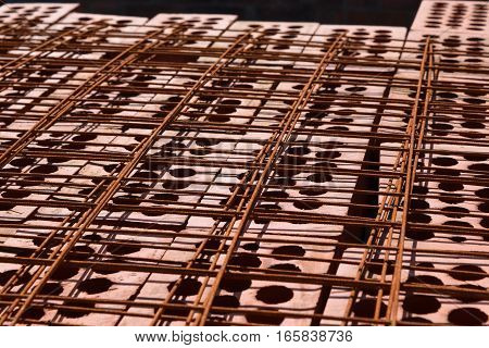 Steel grating on a gray background. steel