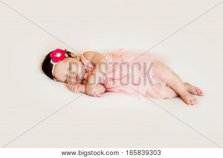 Baby girl sleeping in a white blanket