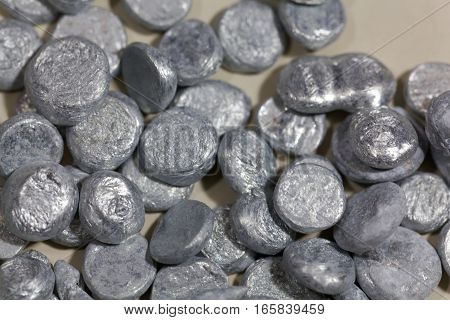 Grains of zinc granulate for metal production.