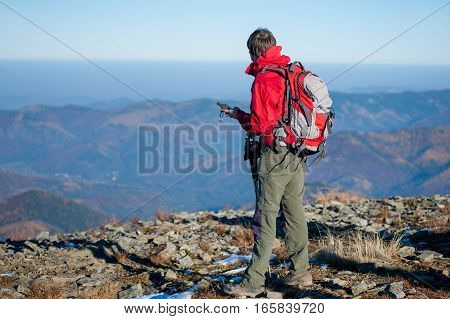 Man Backpacker On The Peak Of The Mountain