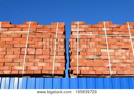 Red Bricks Stacked Into Cubes. Warehouse Bricks. Storage Brickworks Products