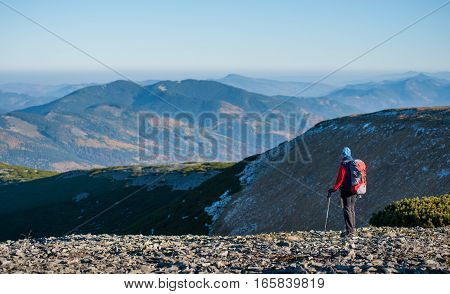 Old Female Tourist Enjoying The Open View On The Mountains