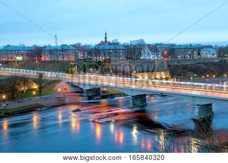 NARVA, ESTONIA - JANUARY 1, 2017: Bridge of Friendship with pedestrian tunnel over Narova River between Narva in Estonia and Ivangorod in Russia. Here is the border of two countries. View from Russia