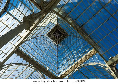 Madrid 28 Sept: View of the ceiling inside Madrid's Crystal Palace. Palacio de Cristal a glass and metal structure built by Ricardo Velazquez Bosco in 1887 to exhibit flora and fauna from the Philippines on Buen Retiro Park in Madrid Spain.