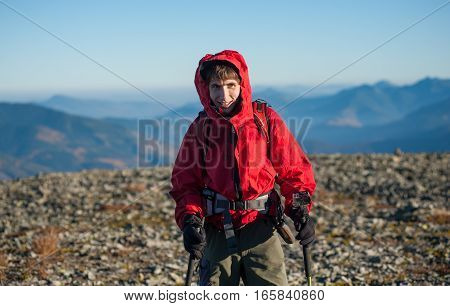 Portrait Of Male Hiker On The Top Of The Mountain