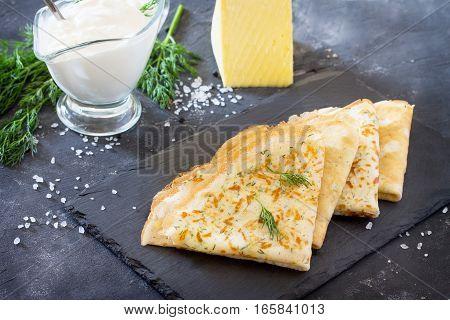Pancakes With Cheese And Fresh Dill, Served With Sour Cream On A Slate Board. Breakfast, Snack Or Br