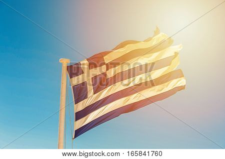 Old flag of the Greece in the wind