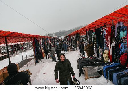 Calugareni Romania December 20 2009: People are buying different products in the animal market in Calugareni. Before Christmas animal breeders are selling and sacrificing their animals in animal markets and vendors are selling different products.