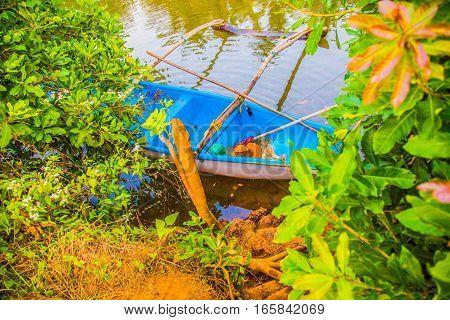 Fishing boat on indian river, Goa, India