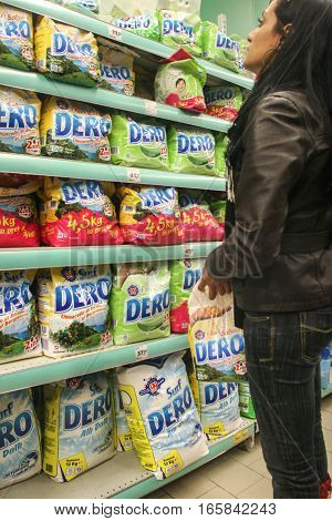 Bucharest Romania 17 January 2017: A woman is looking at detergents in a supermarket in Bucharest.