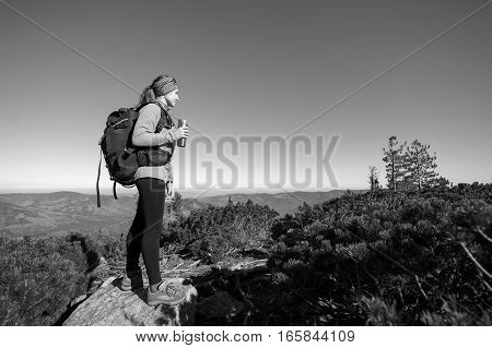 Woman Backpacker Standing On Peak Of The Mountain
