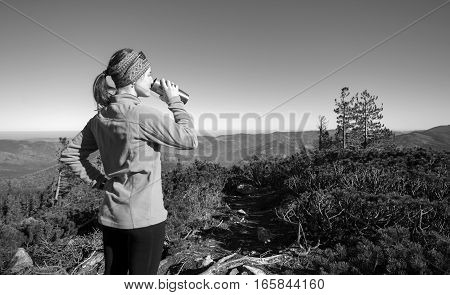 Young Woman Drinking Tea Out Of Thermos