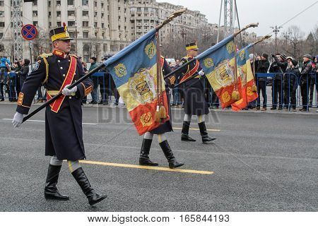 BUCHAREST ROMANIA - November 29 2015: Military are marching during a rehearsal for National Day of Romania military parade in Bucharest. More than 3000 soldiers and personnel from security agencies take part in the massive parades on National Day of Roman