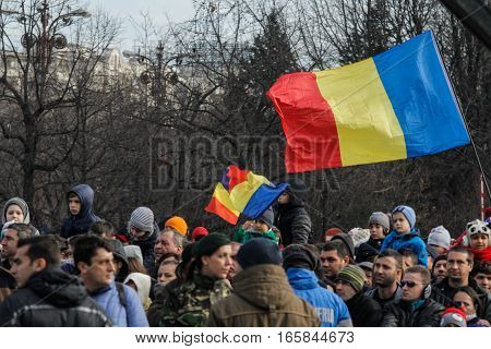 BUCHAREST ROMANIA DECEMBER 1 2015: People are watching the military parade on National Day of Romania. More than 3000 soldiers and personnel from security agencies take part in the massive parades on National Day of Romania.