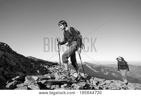 Young Hiker Couple Climbing Up Rocky The Mountain Top