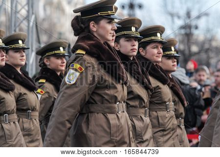 BUCHAREST ROMANIA DECEMBER 1 2015: Military women are marching for the National Day of Romania military parade in Bucharest. More than 3000 soldiers and personnel from security agencies take part in the massive parades on National Day of Romania.