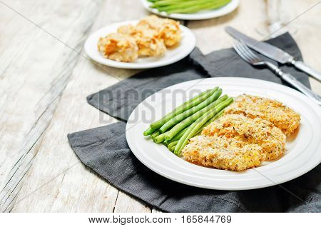 Bread crumbs cheese herbs baked cod with green beans.