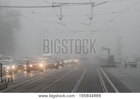 Bucharest Romania January 10 2014: Urban scene on a foggy day in Bucharest.