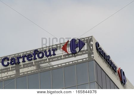 Bucharest Romania December 2 2015: Carrefour store logo French international hypermarket chain.