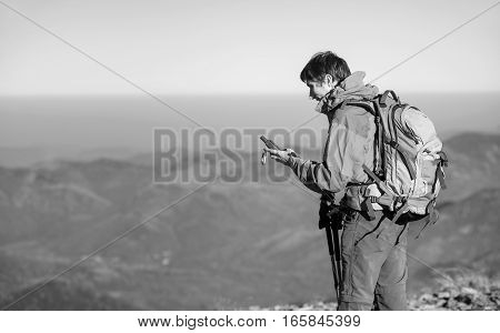 Portrait Of Man Backpacker Standing On Peak Of The Mountain