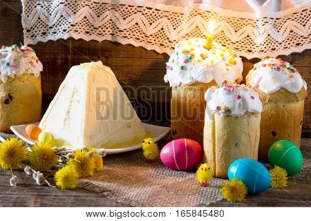 The Traditional Easter Treats: Cakes And Colorful Easter Eggs On A Table In A Rustic Style. Copy Spa