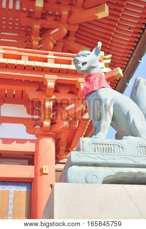 Fox statue at Fushimi Inari shrine in Kyoto Japan