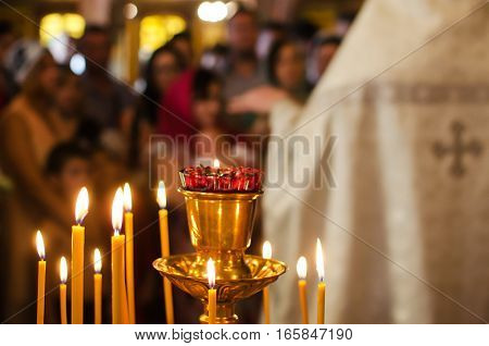 Stand for candles in the interior of the Russian Orthodox Church. Shallow depth of field. icon lamp