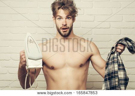 Young Topless Man With Iron