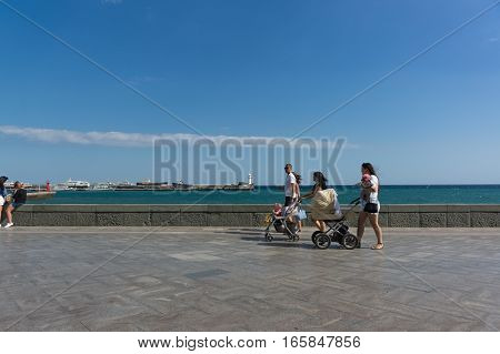 YALTA CRIMEA RUSSIA - SEPTEMBER 12.2016: The young family is on the seafront of Yalta