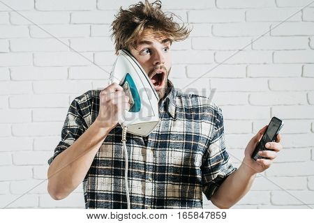 Surprised Man With Iron And Phone
