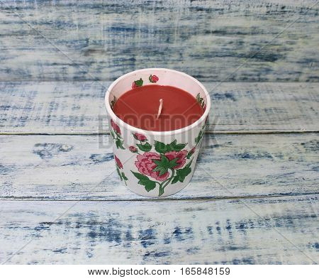 A candle in a beautiful candlestick handmade decoupage