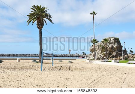 NEWPORT BEACH CALIFORNIA - JANUARY 6 2017: Corona del Mar State Beach. Rock Formation at Corona del Mar State Beach Newport Beach California with the jetty in the background.