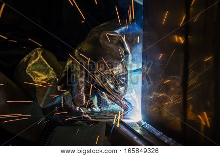Sparks from an Industrial steel welder craftsman in factory